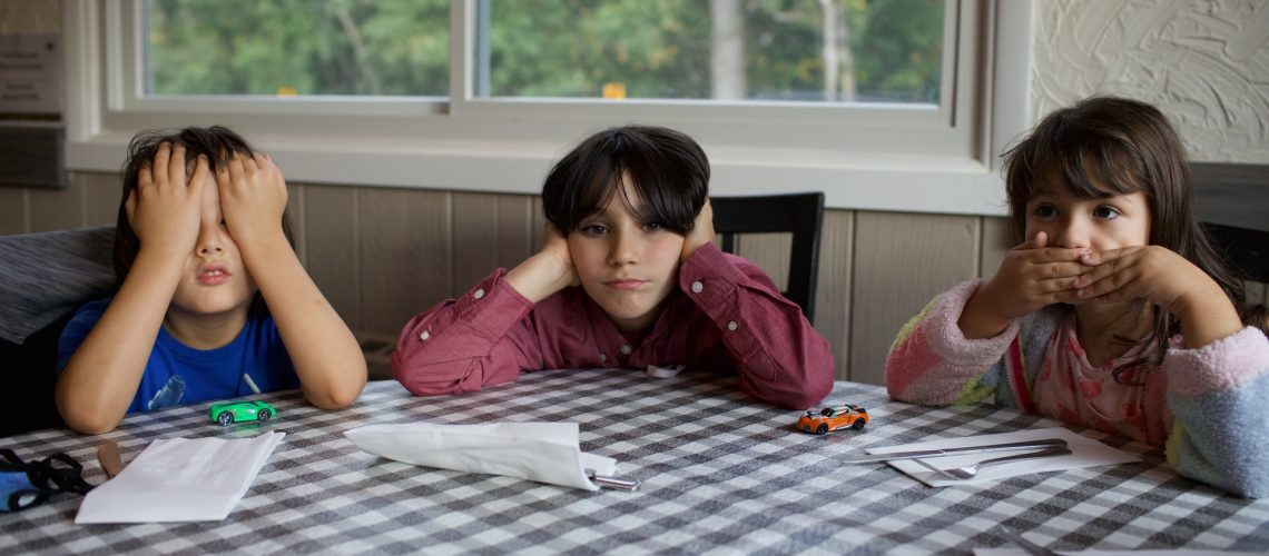 Photo of kids sitting at the kitchen table